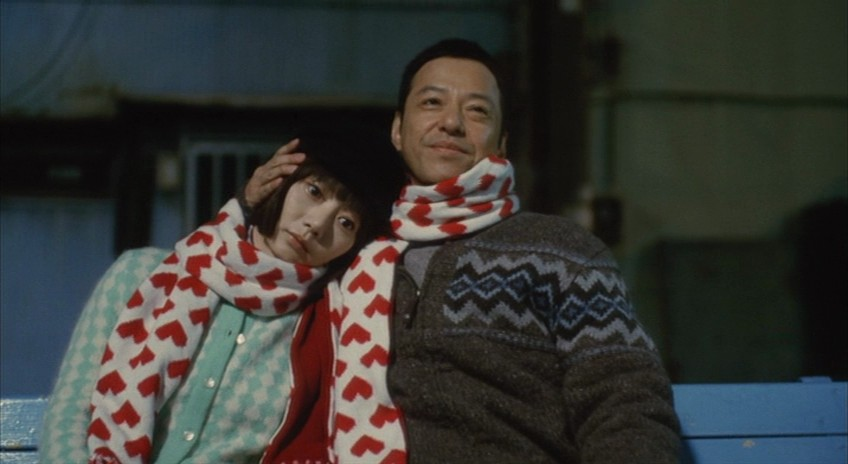 Nozomi e seu dono, enquanto ela tenta manter seu papel de boneca vazia.